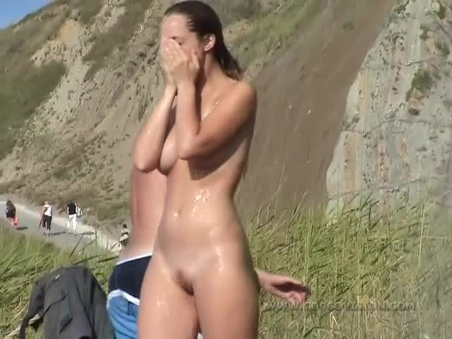 Nudists Showering at the Beach
